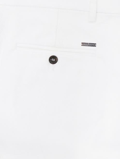 Узкие брюки из хлопка - Деталь