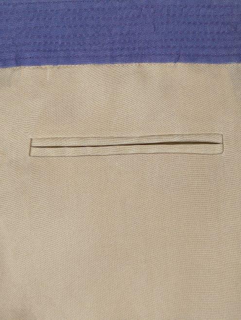 Укороченные брюки из шелка - Деталь